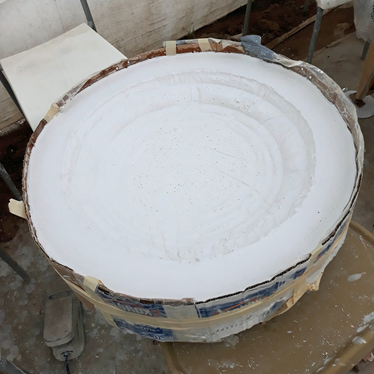 Wet plaster that can be worked with tools